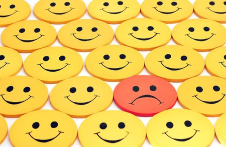 Happy crowd except one - see portfolio for more smilies Reklamní fotografie - 3231967