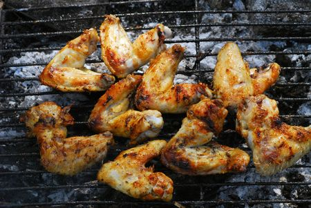 open the wings: chicken wings on barbecu grill