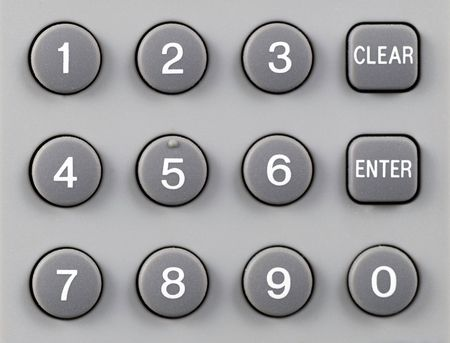 Remote control numeric keypad with clear and enter buttons photo