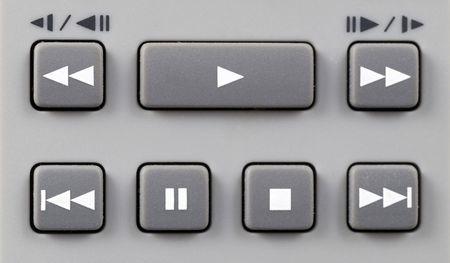 Grey remote control playback keypad with white symbols