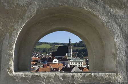 cz: Magical old town Cesky Krumlov in Bohemia - view through window in castle wall