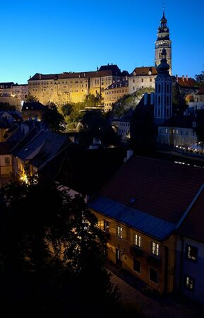 cz: Night shot of magical castle in Cesky Krumlov in Bohemia domination on town streets