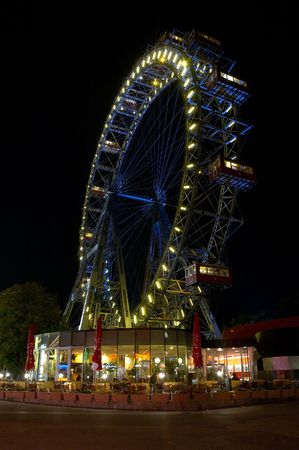 iluminate: Fragment of prater - giant old ferris wheel in Wien Austria. The wheel is more that 100 years old
