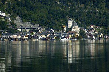 View on Hallstatt town from the lake - small town on Hallstatt lake - Salzkammergut - Austria