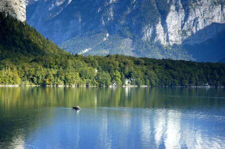 Hallstattersee - mountain lake in salzkammergut with boat photo