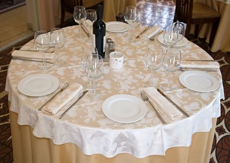 Round table for six persons served and ready in restaurant Stock Photo - 3268994