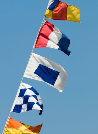 International maritime signal flags on a rigging of yacht Banco de Imagens
