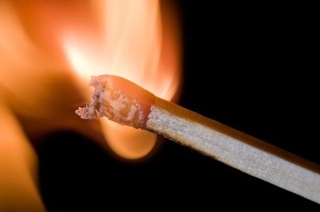 Closeup on burning match just after ignition photo