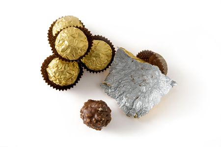 Several isolated chocolate sweets viewed from the top