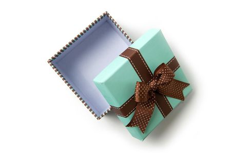 Top view on isolated open striped gift box with brown ribbon Banco de Imagens