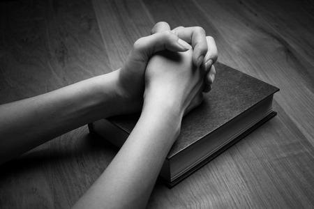 christian women: Woman hands praying with a bible Stock Photo