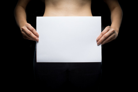 Topless Woman with blank sign - concept photo of sexual assault