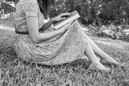 soul searching: Young woman reading bible in natural park