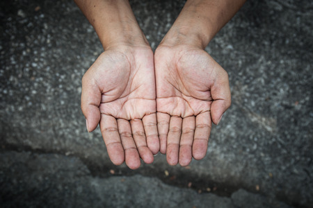old beggar: Beggar people and human poverty concept - person hands begging for food or help Stock Photo