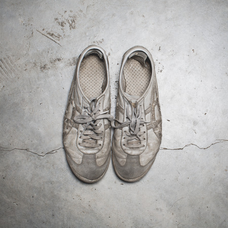 an old shoes on the cement floor photo