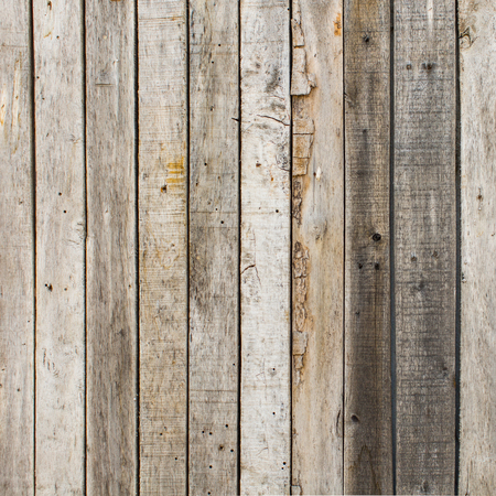 wooden planks: rustic weathered barn wood background with knots and nail holes