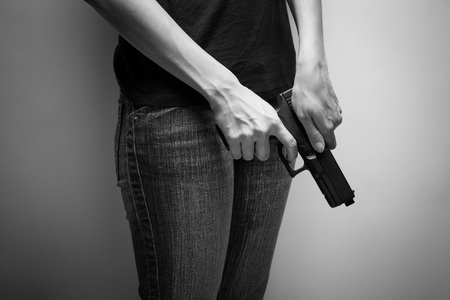 concealing: Girl Officer Concealing Weapon