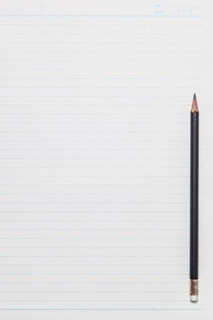notebook paper background with pencil