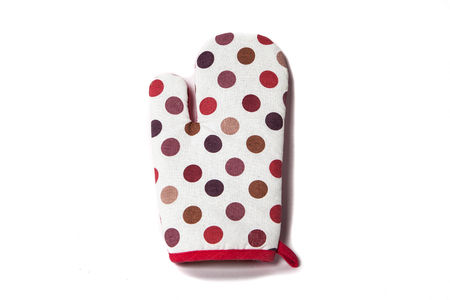 fireproof: oven gloves in color polka dot Stock Photo