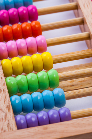 calculator chinese: Chinese calculator with colorful beads-abacus Stock Photo