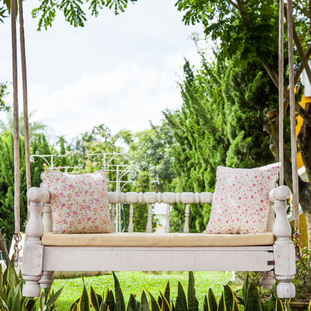 folwer: vintage swing and light pink flower pillow
