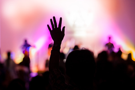 hands raised: christian music concert with raised hand