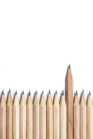 nonconformity: One wood pencil standing out from the row