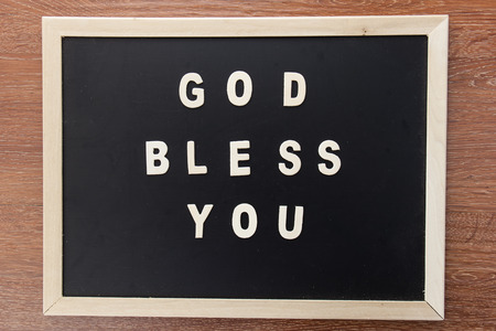 god bless: wood letters text form bible GOD bless you on chalk board.