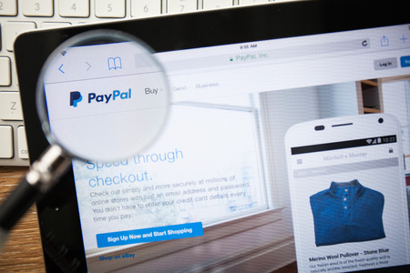 paypal: CHIANGMAI, THAILAND - FEBRUARY 15, 2015: Photo of paypal.com homepage on a apple ipad screen.