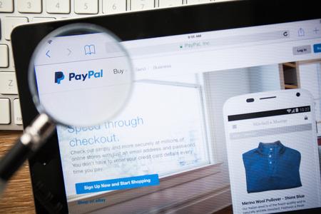 CHIANGMAI, THAILAND - FEBRUARY 15, 2015: Photo of paypal.com homepage on a apple ipad screen.