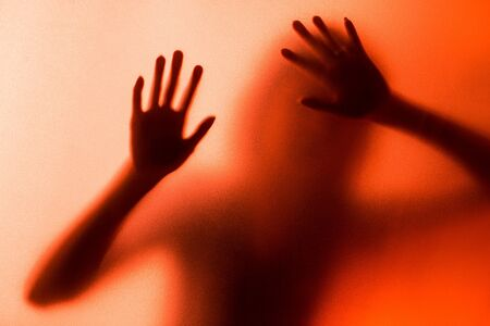 coercion: silhouette of action of woman scream Stock Photo