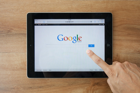 Chiangmai,Thailand - February 9, 2015: A Google search home page on a ipad screen, new app for mobile devices
