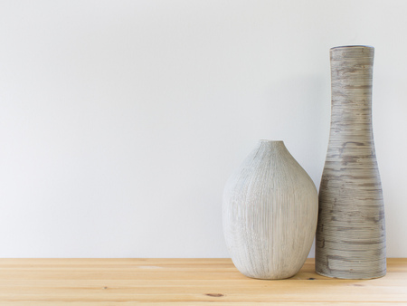 Detail shot of contemporary vases on the wooden shelf. Interior design.