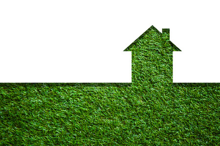 real estate background: graphic shape of House in green field Stock Photo