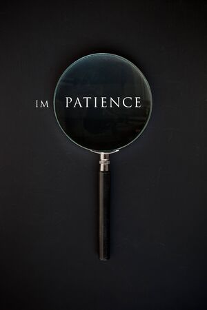 impatience: Patience Word Through Magnifying Glass Stock Photo