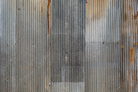 hangar: A rusty corrugated iron metal texture.