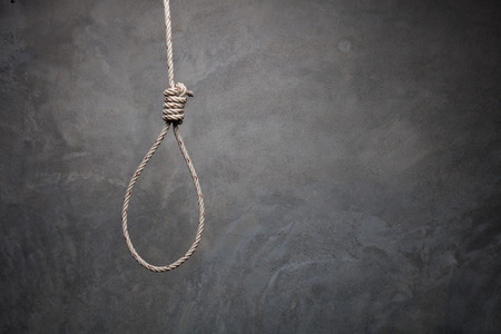 Hands holding rope slipknot in concept suicide Stock Photo
