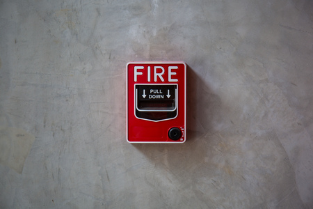 safe and sound: fire alarm switch on the wall