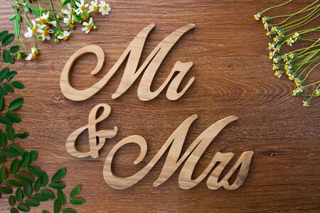 mr and mrs: Word Mr. and Mrs on wooden background Stock Photo