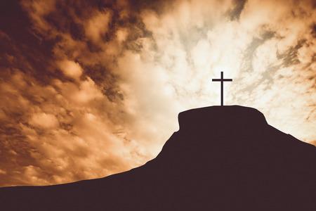Vintage toon van kruis op een heuvel Stockfoto