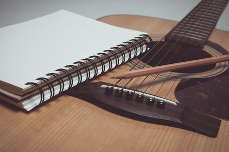 pencil and paper: Pencil and paper on guitar in vintage style