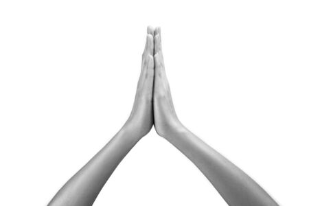 womans hands: Womans hands praying against a white background Stock Photo