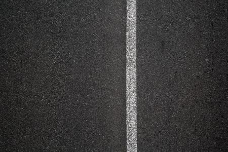 een grijze weg Stockfoto