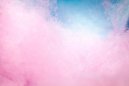 背景の柔らかい色でカラフルな綿菓子