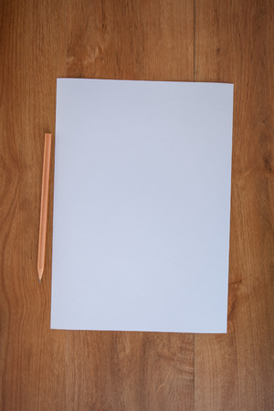 notebook paper background: white paper and pencil on wood table