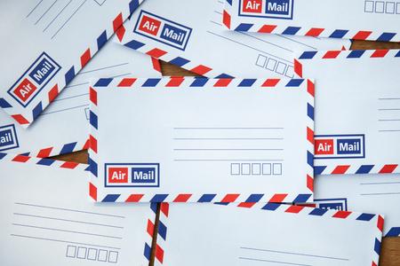 par avion: envelope on wooden background