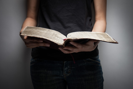A close-up of a christian woman reading the bible.