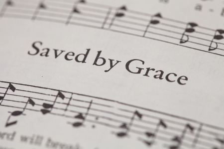 sheetmusic: CHIANGMAI, THAILAND, April 21,2015. Singing The Christian Hymnal book on the song of  Saved by Grace  at home. April 21,2015 Editorial