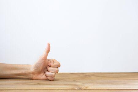 hand showing thumbs up: Hand showing thumbs up gesture Stock Photo