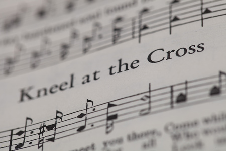sheetmusic: CHIANGMAI, THAILAND, April 21,2015. Singing The Christian Hymnal book on the song of  Kneel at the Cross  at home. April 21,2015 Editorial
